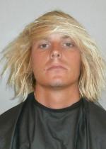 Arrested for pot possession, probation violation.