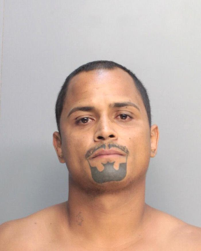 Arrested for resisting an officer, obstruction by disguise.