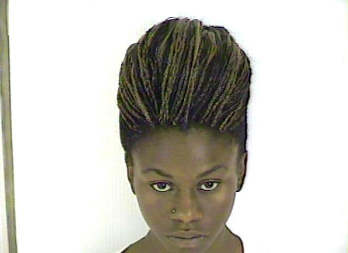 Arrested for cruelty to a child, fleeing police, and reckless driving.