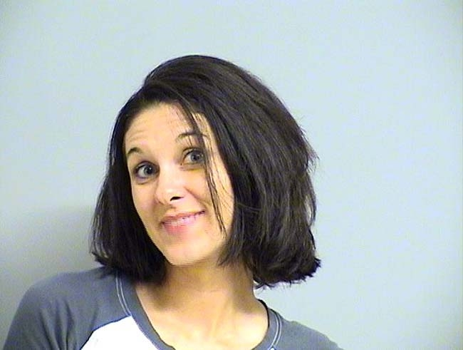 Arrested for speeding, improper license plate display.