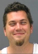 Arrested for burglary, larceny, and false statements.