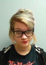 Arrested for resisting an officer, vandalism.