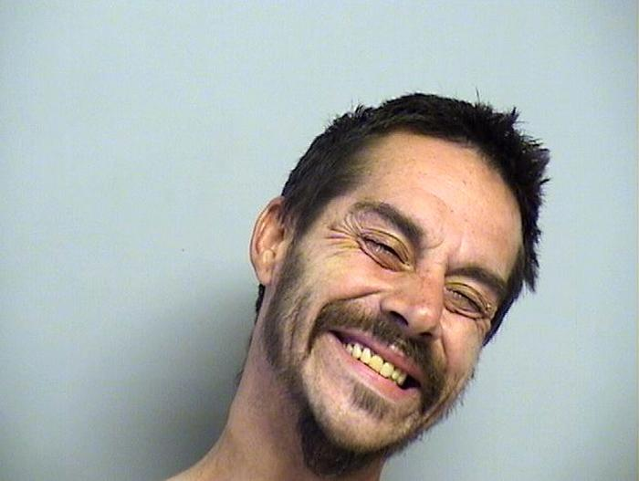 Arrested for carrying a weapon, public intoxication, and resisting arrest.