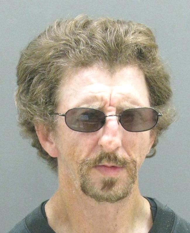 Jailed while awaiting arraignment.