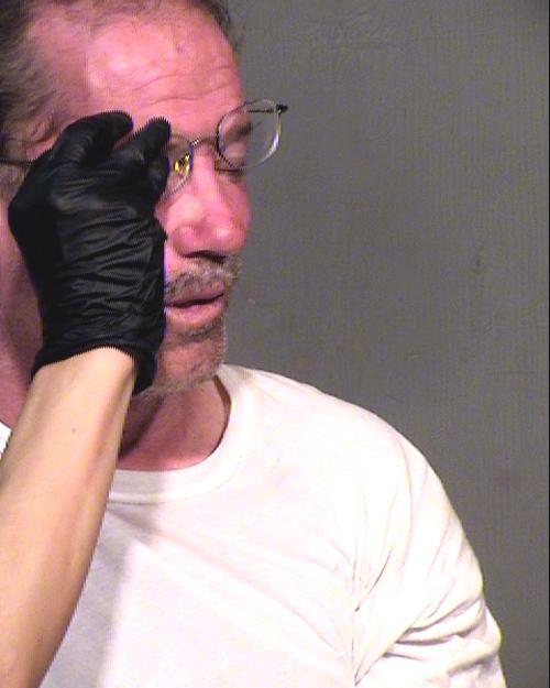Arrested for assault, criminal trespass.