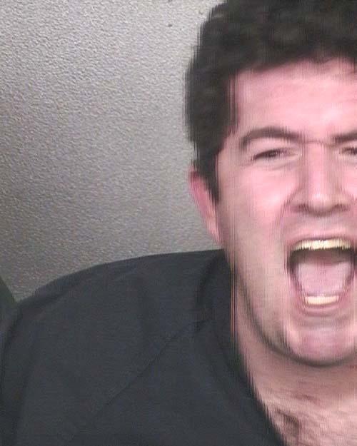 Arrested for violating probation on a stalking charge.