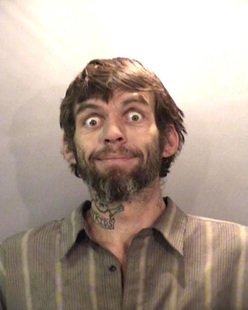 Arrested on a flight warrant.