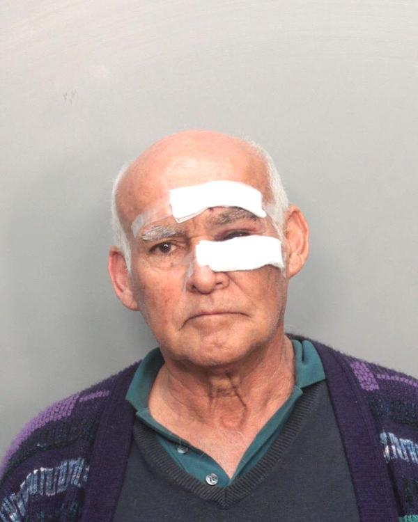 Arrested for battery with a weapon (machete), grand theft.
